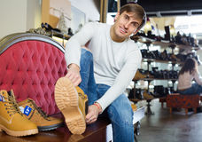 Young man in a shoe store Stock Photos
