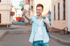 Young man shoot themselves on the phone and winks. Travel Royalty Free Stock Photography