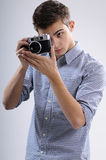 Young man shooting. Young, talented, young man learning to use one camera Royalty Free Stock Photography