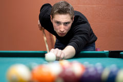 Young Man Shooting Pool Royalty Free Stock Images