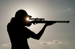 Young man shooting with a rifle Stock Images