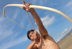 A young man shoots a bow Royalty Free Stock Photos