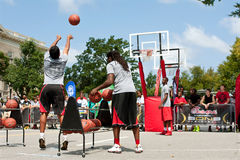 Young Man Shoots Three Pointers In Outdoor Street Basketball Tournament. Athens, GA, USA - August 24, 2013:  A young man takes part in the three-point shot Royalty Free Stock Image