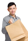 Young man with shopping bag Stock Image