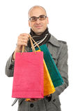 Young man with shopping bags Stock Images