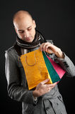 Young man with shopping bags Stock Photos