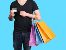 Young man with shopping bags and credit card Stock Image