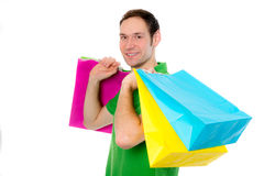 Young man with shopping bags Royalty Free Stock Images