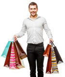 Young man with shopping bags Stock Image
