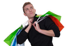 Young man with shopping bags looking up Royalty Free Stock Photo