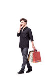 The young man in shopping concept isolated on white Royalty Free Stock Photos