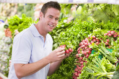 Young man shopping for fresh produce Stock Photos