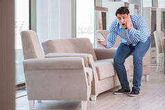 The young man shopping in furniture store Stock Image