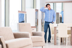 The young man shopping in furniture store Royalty Free Stock Photo