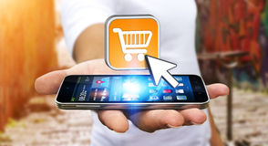 Young man shopping with his mobile phone Royalty Free Stock Image