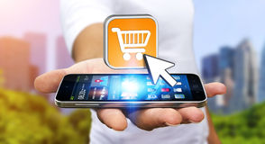 Young man shopping with his mobile phone Stock Photography