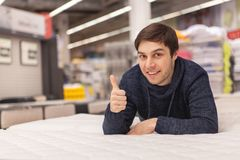 Young man shopping at home furnishing store stock photo