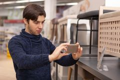 Young man shopping at home furnishing store stock image