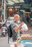 Young Man Shopping on Khao sarn road. Man's Smile after buy pad tai in Khao sarn Road, bangkok thailand royalty free stock photo