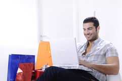 Young man in shopping on-line Stock Images