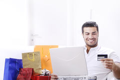Young man in shopping on-line Royalty Free Stock Photos