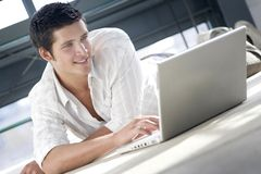 Young man shopping on line stock images