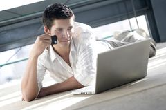 Young man shopping on line Stock Photo