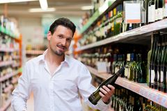 Young Man Shopping for Liquor Royalty Free Stock Images