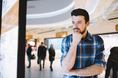 Young man in the shopping mall Stock Images