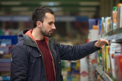 Young Man Shopping In The Supermarket Royalty Free Stock Photo