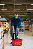 Young Man Shopping In The Supermarket Royalty Free Stock Photography