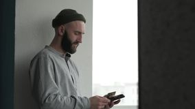 Young man shopping using credit card and digital tablet pc. Young modern man with beard shopping online, using credit card and digital tablet pc for payment stock video footage