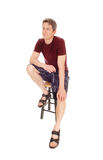 Young man in shorts sitting. Royalty Free Stock Photos