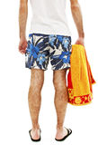 Young man in shorts with towel from the back Stock Photos