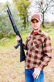 Young Man With Shotgun Royalty Free Stock Photo