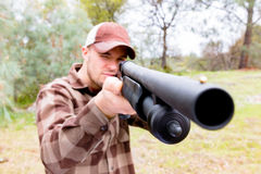 Young Man With Shotgun. Young Man Hunting With Shotgun, Focus is on the Handle of the Gun Royalty Free Stock Photos