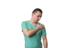 Young Man With Shoulder Pain - White Background. Man Having Pain in Shoulder - Isolated Over White Background Royalty Free Stock Images