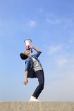 Young man shout megaphone Stock Image