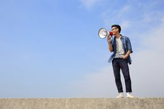 Young man shout megaphone Stock Images