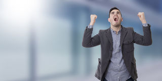 Young man shouting. Adult young man shouting enraged with the arms raised Stock Photography