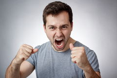 Young man shouting Stock Image