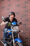 Young man shouting as he speeds on his motorbike Stock Photography