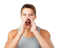 Young man shouting through hands Royalty Free Stock Photography