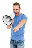 Young man shouting on horn loudspeaker Stock Image