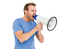 Young man shouting on horn loudspeaker Royalty Free Stock Images