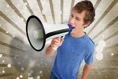 Young man shouting through a megaphone Stock Image