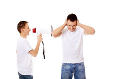 Young man shouting into a megaphone Stock Image