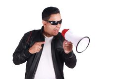 Young Man Shouting with Megaphone, Motivating Concept. Photo image portrait of Asian man shouting with megaphone, mad yelling screaming crazy supporting Royalty Free Stock Photo