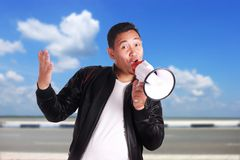 Young Man Shouting with Megaphone, Promotion Concept Royalty Free Stock Images