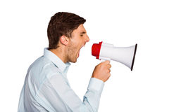 Young man shouting through megaphone Royalty Free Stock Photography